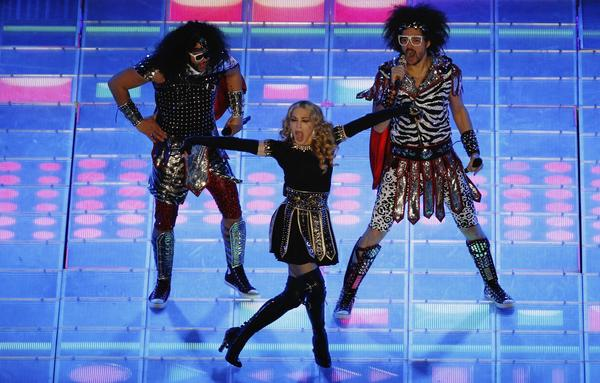 "Madonna's performance at Super Bowl 46 was very interesting. With special guests LMFAO, Nicki Minaj, M.I.A., and Cee Lo Green, Madonna kept the crowd at the edge of their seats. She sang one of her newer songs ""Give Me All Your Luvin,"" ""Sexy and I know it,"" and her classic ""Like a Prayer."""