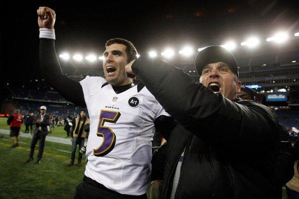 Joe Flacco celebrates the AFC title game victory with Coach John Harbaugh.
