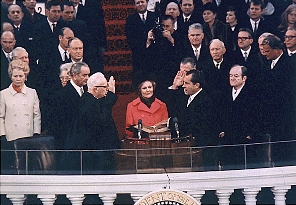 "Richard Millhous Nixon takes the oath of office as he is sworn in as the 37th president of the United States on January 20, 1969. <a href=""http://www.youtube.com/watch?v=rXzgMdj5urs"">Watch President Nixon's first inaugural address here</a>"