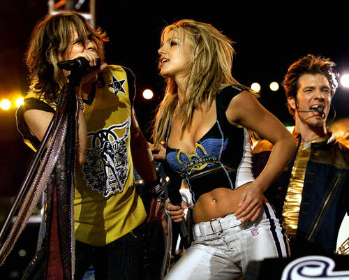"MTV had the honor to produce the famous 35 halftime show. With the theme 'The Kings of Rock and Pop' MTV mixed together songs from Aerosmith, N'SYNC and Britney Spears. The crowd favorite was the song mash-up of ""Bye Bye Bye,"" ""I Don't Want To Miss A Thing,"" ""It's Gonna Be Me,"" and ""Jaded."" Although the performance needed some work MTV definitely chose the most popular artists of that time."