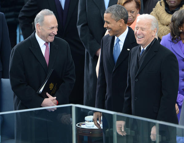 President Barack Obama, arriving to take the oath of office, laughs with Vice President Joe Biden, right, and Sen. Charles E. Schumer (D-N.Y.).