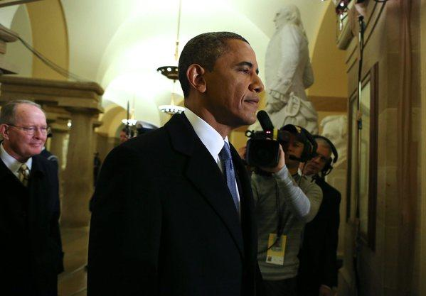 President Obama walks through the Capitol on Monday on his way to being sworn in for a second term.
