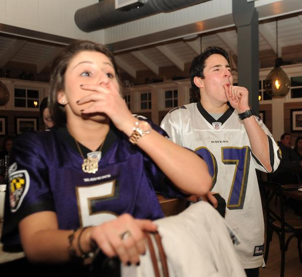 Local fans at a Mt. Washington tavern react to Sunday's telecast of the Ravens AFC Championship victory over the New England Patriots.