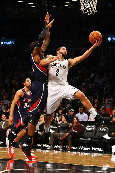 Deron Williams #8 of the Brooklyn Nets goes up against Josh Smith #5 of the Atlanta Hawks during the game at Barclays Center on January 18, 2013 in the Brooklyn borough of New York City.