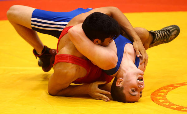 Liam Nelyland of Australia (blue) competes against Matiu Pouri-Lane of New Zealand during the Wrestling on day five of the Australian Youth Olympic Festival at Sydney Olympic Park Sports Halls on January 20, 2013 in Sydney, Australia.