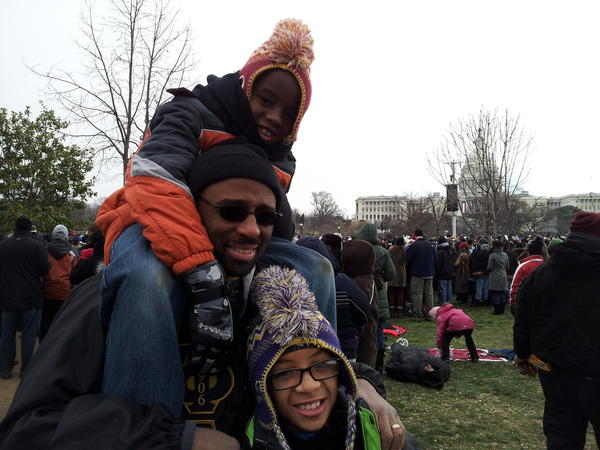 Ty Smith of Bowie attends the inauguration with sons Joshua, 7, on his shoulders, and Jeremiah, 9.
