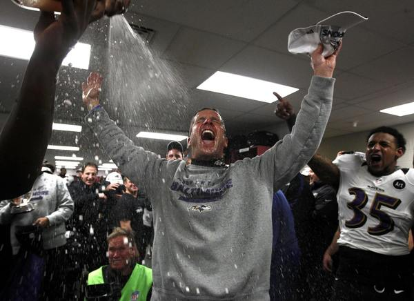Baltimore Ravens head coach John Harbaugh celebrates in the dressing room after his team defeated the New England Patriots in the NFL AFC Championship football game in Foxborough, Massachusetts, January 20, 2013.