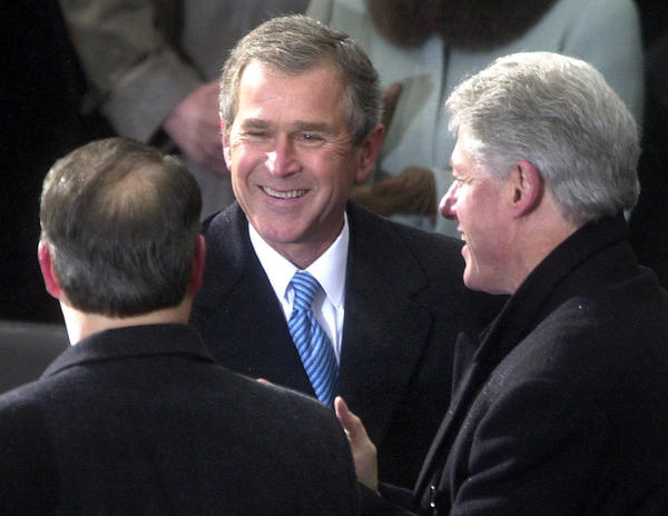 President George W. Bush talks with former vice president Al Gore (left) and former president Bill Clinton during the   Inauguration Ceremony at the U.S. Capitol in Washington, DC, Saturday , Jan. 20, 2001.