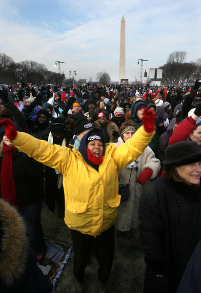 Genevieve Etiene, of Port-au-Prince, Haiti, cheers while braving frigid temeratures to watch President-elect Barack Obama be sworn-in as the 44th President of the United States in Washington, D.C., Tuesday, January 20, 2009.