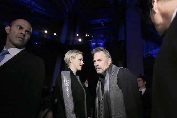 Princess Charlene speaks with actor Kevin Costner before the Haute Couture Spring-Summer 2013 Versace collection show on Sunday in Paris.
