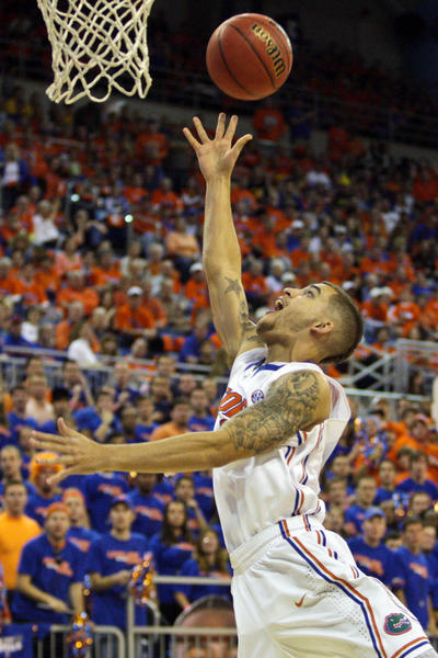 Florida Gators guard Scottie Wilbekin (5) lays the ball up during the first half of the game against the Missouri Tigers at the Stephen C. O'Connell Center.