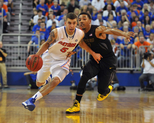 Guard Scottie Wilbekin #5 of the Florida Gators drives up court against the Missouri Tigers January 19, 2013 at Stephen C. O'Connell Center in Gainesville, Florida. The Gators won 83 - 52.