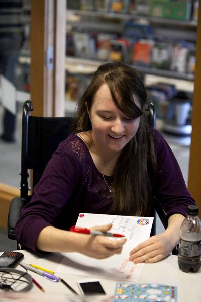 "Jen Rubino, 18, makes greeting cards for hospitalized children in the Des Plaines Public Library. Rubino foiunded the organization Cards for Hospitalized Kids at age 16. ""After my 13th surgery…I received a bunch of cards in the hospital, and they really helped me. ... At that point I wanted to do that for other kids."""