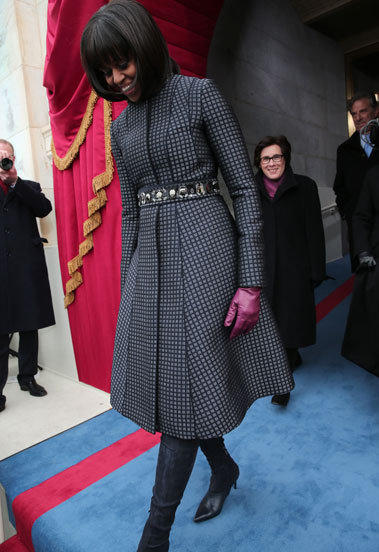 First Lady Michelle Obama arrives during the presidential inauguration wearing a Thom Browne coat.