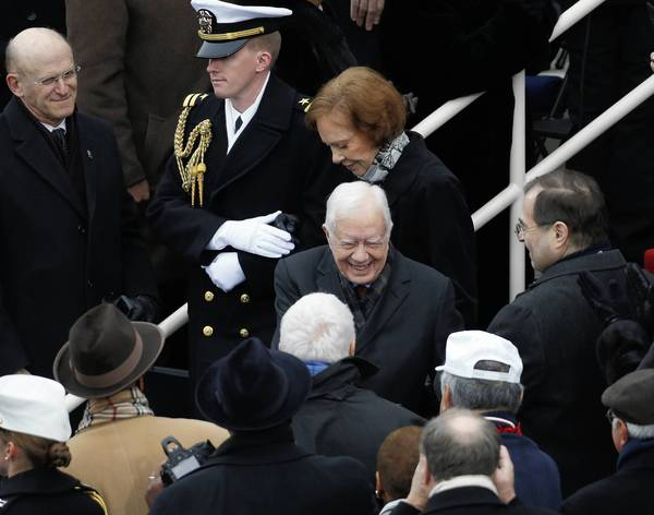 Former President Jimmy Carter and his wife Rosalynn attend the inauguration ceremony for President Barack Obama.