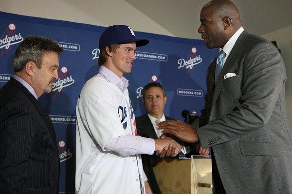 Magic Johnson (r) with new acquisition Zack Greinke