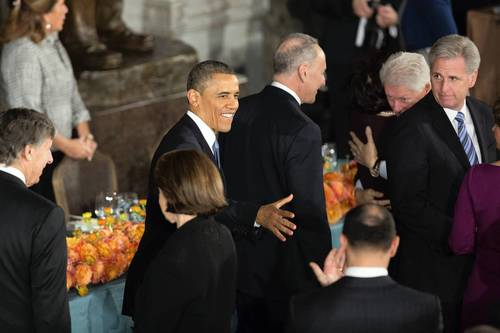 President Barack Obama shakes hands as he arrives at the Inaugural Luncheon in Statuary Hall on inauguration day at the U.S. Capitol.