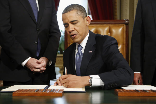 President Obama signs nominations on Capitol Hill following his inauguration ceremony.
