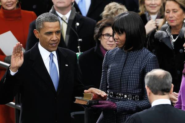 U.S. Supreme Court Chief Justice John Roberts (2nd from R) administers the oath of office to U.S. President Barack Obama as first lady Michelle Obama and daughters Malia and Sasha look on during ceremonies on the West front of the U.S Capitol.
