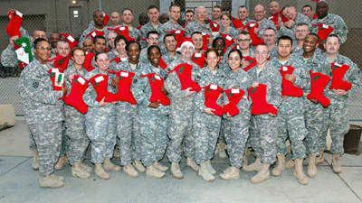 The picture is of the 316 Expeditionary Sustainment Command Group in Kuwait who received cards from the CARDS FOR TROOPS PROJECT