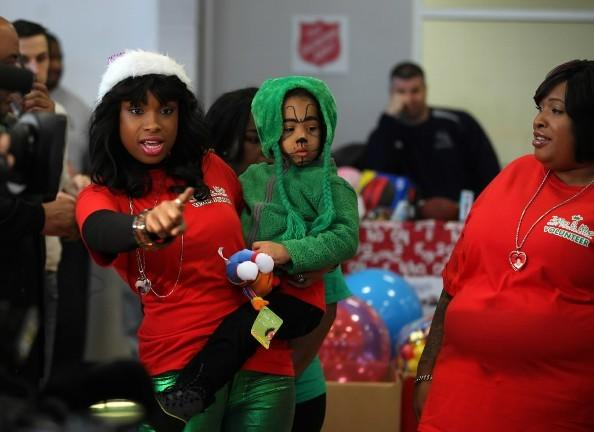 Jennifer Hudson (left) points out the toys to her son David Otunga Jr. (middle) as her sister, Julia (right), looks on during the Julian D. King Gift Foundation Christmas Toy Giveaway at the Ray and Joan Kroc Center Dec. 24, 2012.