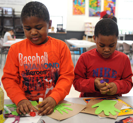 "Levi Levy, 6, of Bethlehem and Randolf Starling, 5, of Easton, do crafts at the Easton Area Community Center and Northampton Community College's Day of Service ""Paying it Forward"" held at the Easton Area Community Center in honor of Martin Luther King Jr. Day."