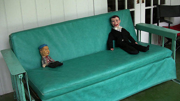 "Rodney McMillian's video ""Dummies on a Porch Swing (Lee Atwater Interview, 1981),"" 2012."