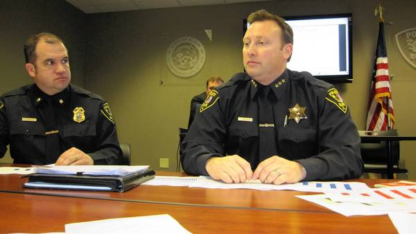 Elgin Police Chief Jeff Swoboda, right, and Cmdr. Glenn Theriault discuss the 2012 crime statistics. Crime is at a 40-year low, according to their report.