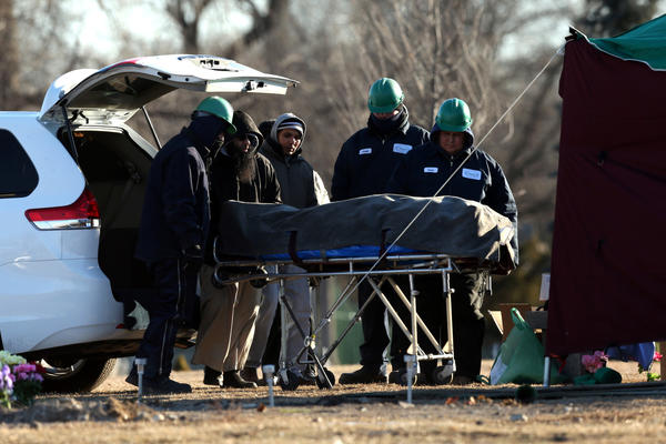 The body of Urooj Khan is wheeled to his gravesite for reburial at Rosehill Cemetery in Chicago on Monday, Jan. 21, 2013. Scott Strazzante/Chicago Tribune