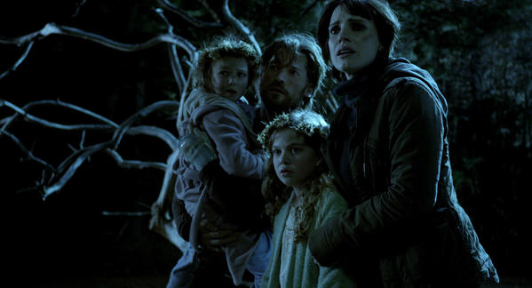"This film image released by Universal Pictures shows, from left, Isabelle Nélisse, Nikolaj Coster-Waldau, Megan Charpentier and Jessica Chastain in a scene from ""Mama."""