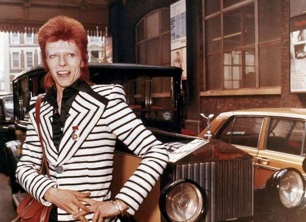 David Bowie poses with his Rolls Royce in 1973. The British rocker is the subject of a retrospective exhibition opening in March at London's Victoria and Albert Museum.