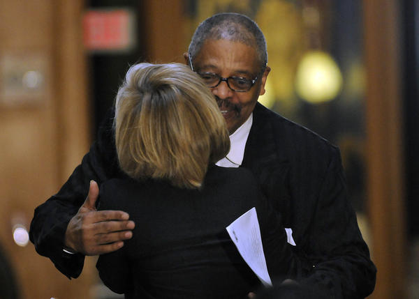 Rev. Dr. Bradford Howard, Jr., Commissioner of the Connecticut Martin Luther King, Jr. Holiday Commission, hugs Diane Lucas, with the Glastonbury MLK Community Initiative, after awarding her a Community award at Connecticut's 27th annual Martin Luther King, Jr. Holiday Celebration at the state Capitol Monday morning.