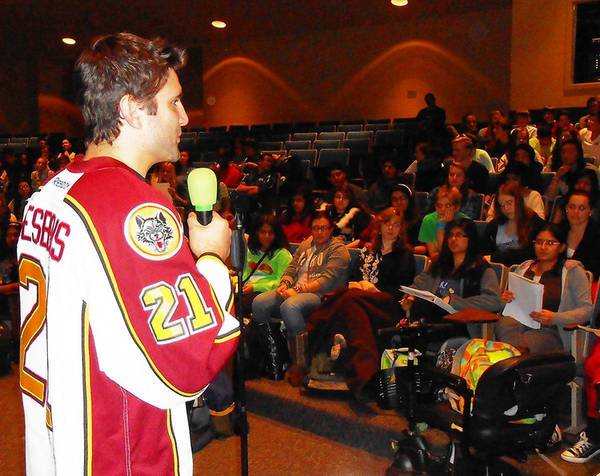 Guillaume Desbiens of the Chicago Wolves talks about hockey and other things -- in French -- to students at Waubonsie Valley High School