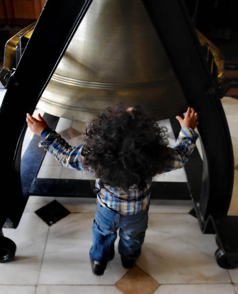 Bear McLaren, 1 1\2, of Wethersfield, sizes up the Liberty Bell replica at the state Capitol during Connecticut's 27th annual Martin Luther King, Jr. Holiday Celebration Monday morning. At the end of the event, the bell was rung three times by three honorees at the celebration.