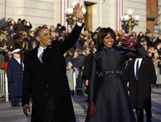 President Obama and First Lady Michelle Obama walk down Pennsylvania Avenue during the 57th Presidential Inauguration parade. They will attend two inaugural balls Monday night.