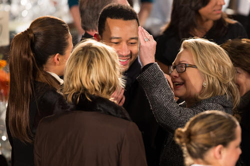 Hillary Clinton pets John Legend like a pretty little puppy.