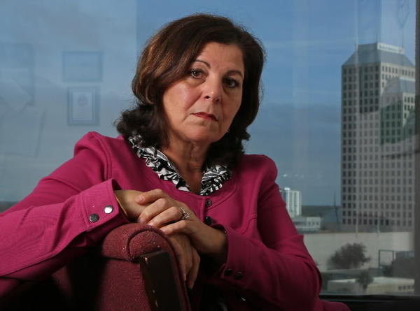 Florida Department of Children and Families Central Region Criminal Justice Coordinator Sue Aboul-hosn in her downtown Orlando, Fla. office, Friday, January 18, 2013.