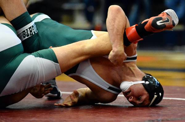 Pen Argyl's Mikey Racciato (right), a two-time Class 2A state champion, is dominating the 145-pound weight class. He is off to a 24-0 start this season and has pinned his last seven opponents.