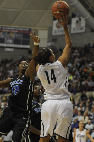 University of Connecticut Huskies guard Bria Hartley shoots over Duke Blue Devils guard Chelsea Gray during the first half.