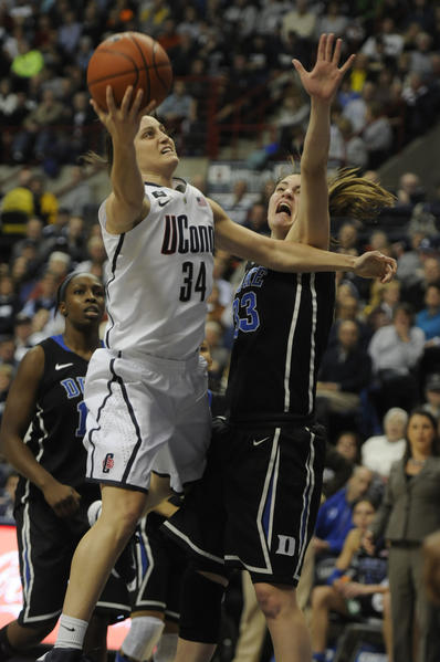 University of Connecticut Huskies guard Kelly Faris shoots over Duke Blue Devils guard/forward Haley Peters during the first half.