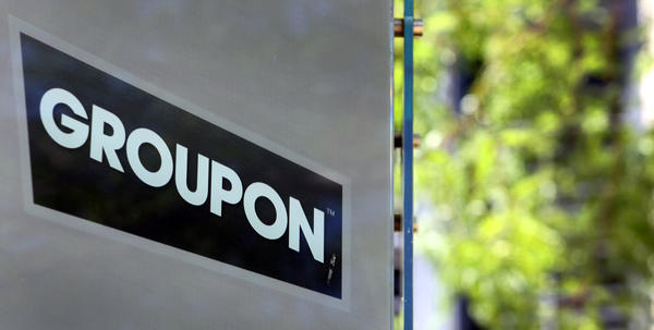 Groupon Inc. signage is displayed outside of company headquarters in Chicago, Illinois.