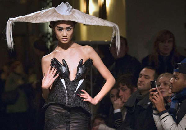 "A model presents a creation made with hair by Charlie Le Mindu, hairdresser and designer, during a ""Haute Coiffure"" fashion show on January 21, 2013 in Paris. Charlie is a French designer that created an outfit and various hats and headpieces worn by Lady Gaga."