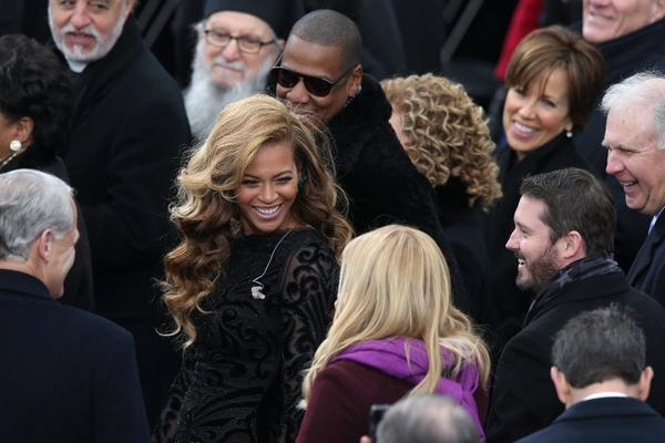 Beyonce and Jay-Z chat with singer Kelly Clarkson after Beyonce sang the national anthem at the 2013 inauguration.