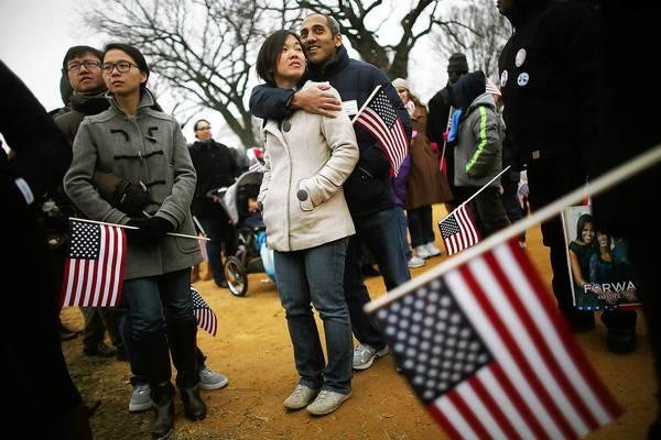 Crowds gather on the National Mall to watch President Obama's inauguration ceremony.