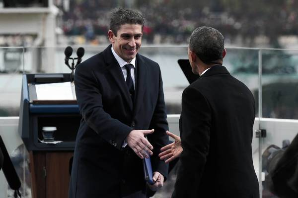 Richard Blanco, left, a gay poet, read at President Obama's inaugural ceremonies Monday. Above, Obama greets him.