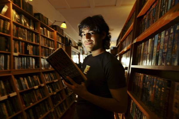 Aaron Swartz poses in a Borderland Books in San Francisco on Fe. 4, 2008. Internet activist and programmer Swartz, who helped create an early version of RSS and later played a key role in stopping a controversial online piracy bill in Congress, has died at age 26, an apparent suicide, New York authorities said Jan. 13.