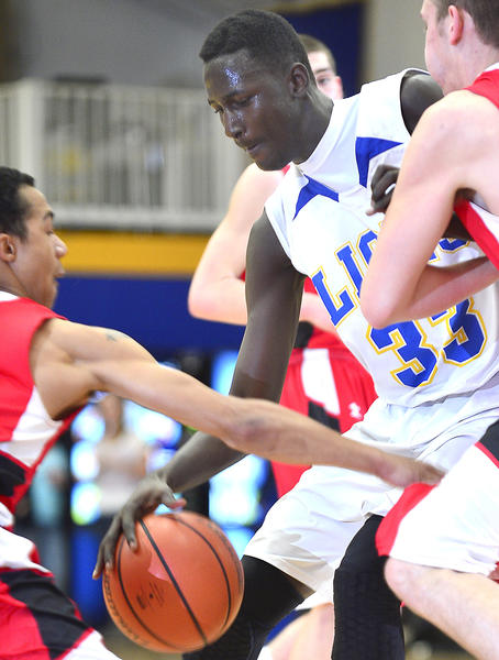 Broadfording Christian Academy's Mowdo Sallah (33) makes a strong move past Fort Hill's Delonte Stewart and Dave Proetti on Monday during the Lions' 60-58 come-from-behind victory.