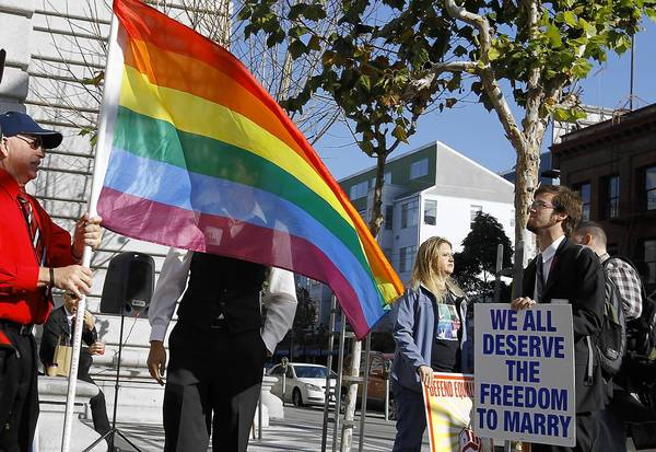 "Supporters of same-sex marriage demonstrate outside a San Francisco courthouse in 2011. ""If we are truly created equal,"" President Obama said in his inaugural address Monday, ""then surely the love we commit to one another must be equal as well."""