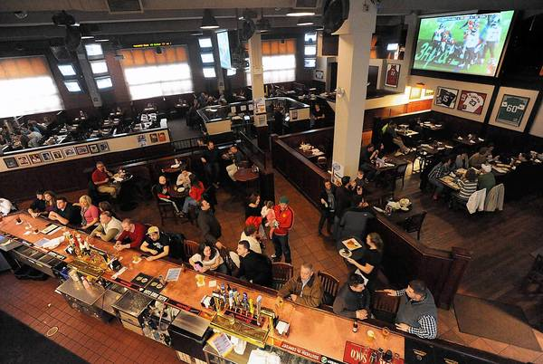 Local sports fans hang out at Starters Riverport in Bethlehem to watch the NFL playoffs Saturday, January 12. The popular restaurant is on the verge of closing.
