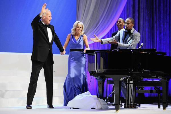 Vice President Joe Biden (L) and Dr. Jill Biden wave goodbye after actor and musician Jamie Foxx (R) sang while they danced at the Commander in Chief Inaugural Ball at the Walter Washington Convention Center Monday night in Washington, DC. Biden and President Barack Obama each took their oath of office earlier in the day.